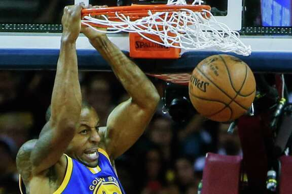 Andre Iguodala dunks during Game 6 of the NBA Finals against the Cavaliers at the Quicken Loans Arena on June 16 in Cleveland.