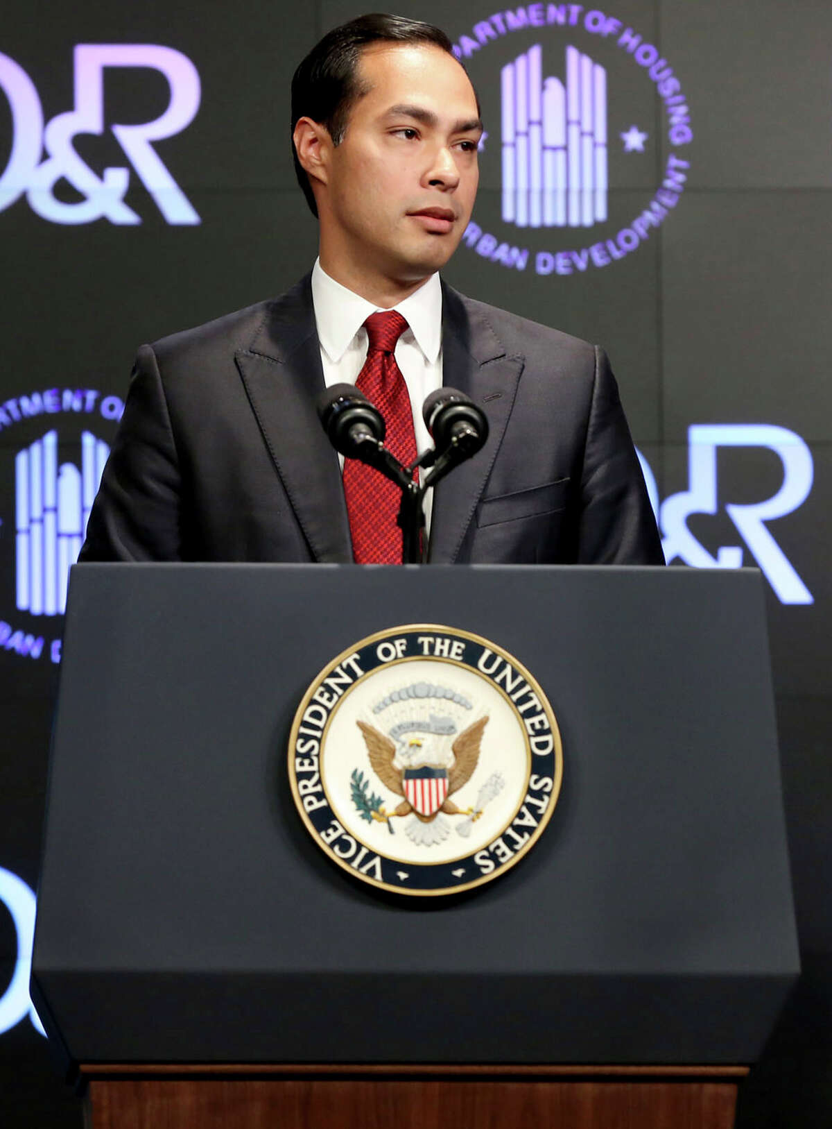 Housing and Urban Development Secretary Julian Castro introduces Vice President Joe Biden at a housing development conference Tuesday, April 7, 2015 in Washington. U.S. Rep. Joaquin Castro says Congress has been sufficiently sensitive to remove words like