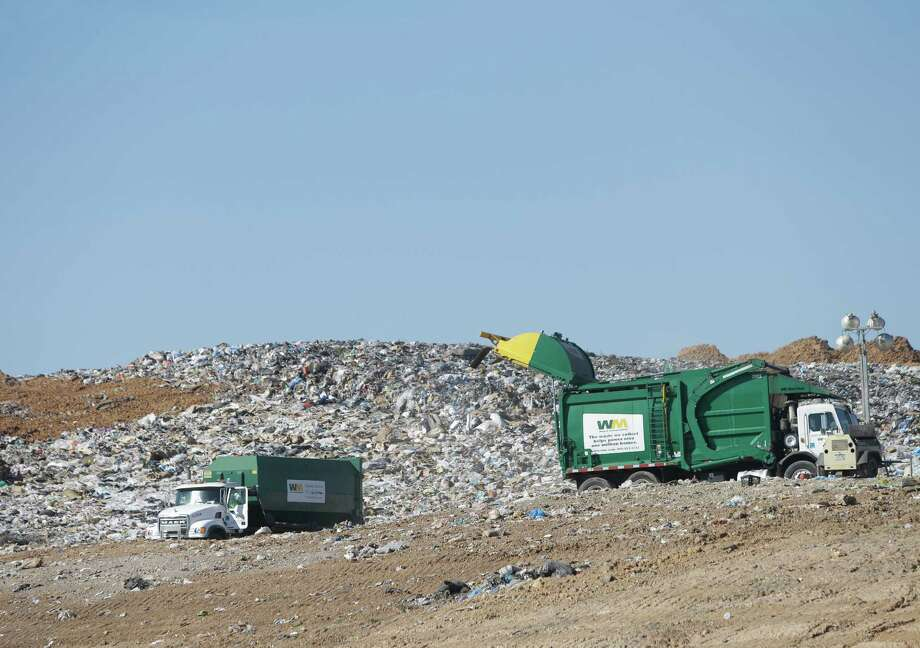 Trash is shown being hauled into the landfill at the Waste Management Atascocita Recycling and Disposal Facility, 3623 Wilson Road, is shown Thursday, Oct. 15, 2015, in Humble. ( Melissa Phillip  / Houston Chronicle ) Photo: Melissa Phillip, Staff / © 2015 Houston Chronicle