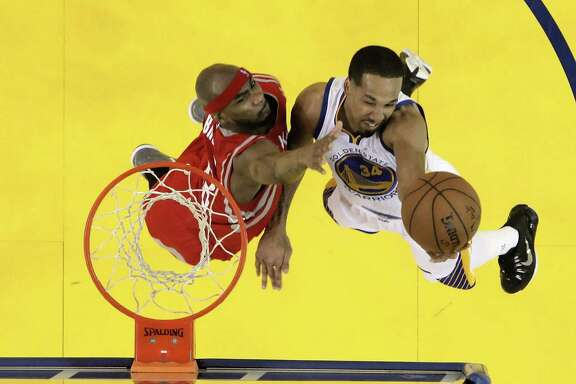 Shaun Livingston shoots over the Rockets' Corey Brewer in Game 1 of the Western Conference Finals on May 19. The Warriors defeated the Rockets 110-106.