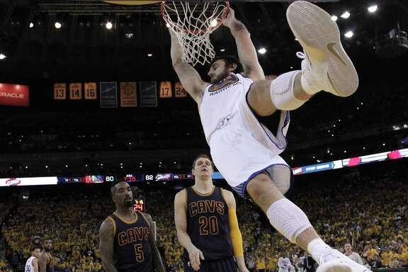 Andrew Bogut dunks during Game 1 of the NBA Finals against the Cleveland Cavaliers at Oracle Arena on June 4