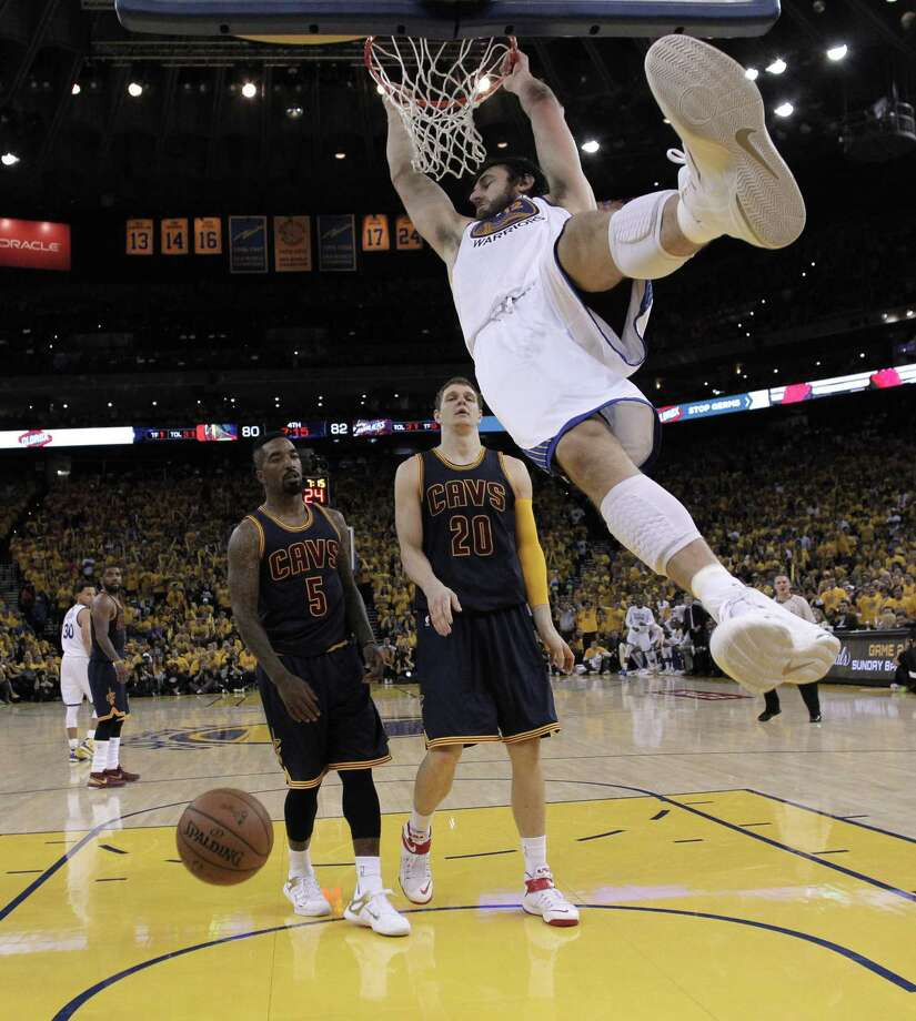 Andrew Bogut dunks during Game 1 of the NBA Finals against the Cleveland Cavaliers at Oracle Arena on June 4 Photo: Carlos Avila Gonzalez / Carlos Avila Gonzalez / The Chronicle / ONLINE_YES