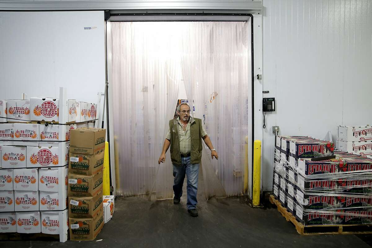 Gus Vardakastanis exits a refrigerated area at North Bay Produce in the San Francisco Wholesale Produce Market in San Francisco, California, on Thursday, Oct. 22, 2015.