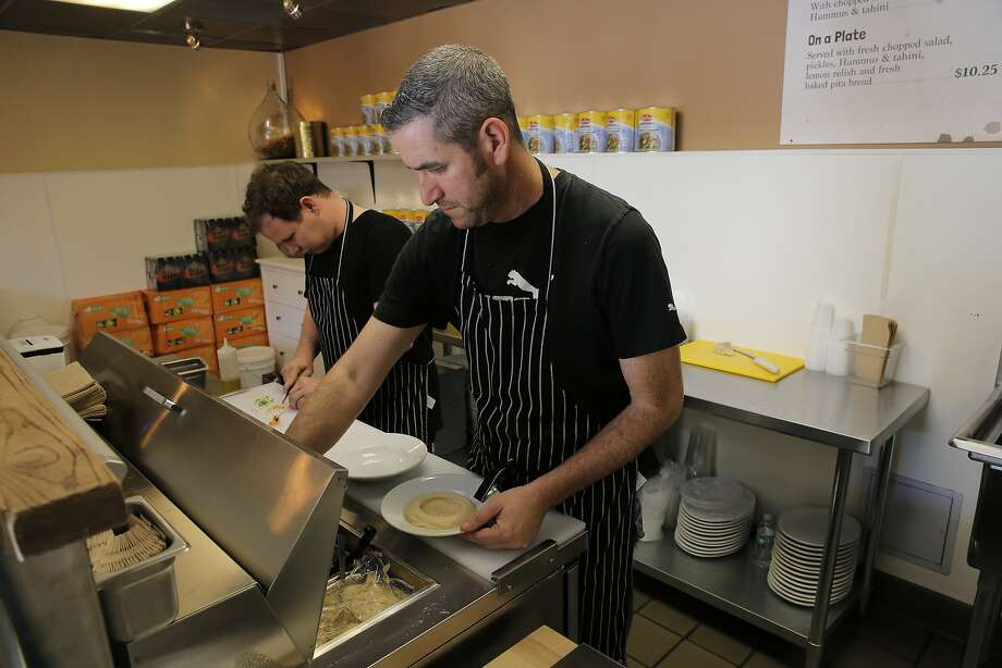 Eli Epstein (left) and owner Mike Lewis of Village Hummus in San Mateo. Photo: Michael Macor, The Chronicle