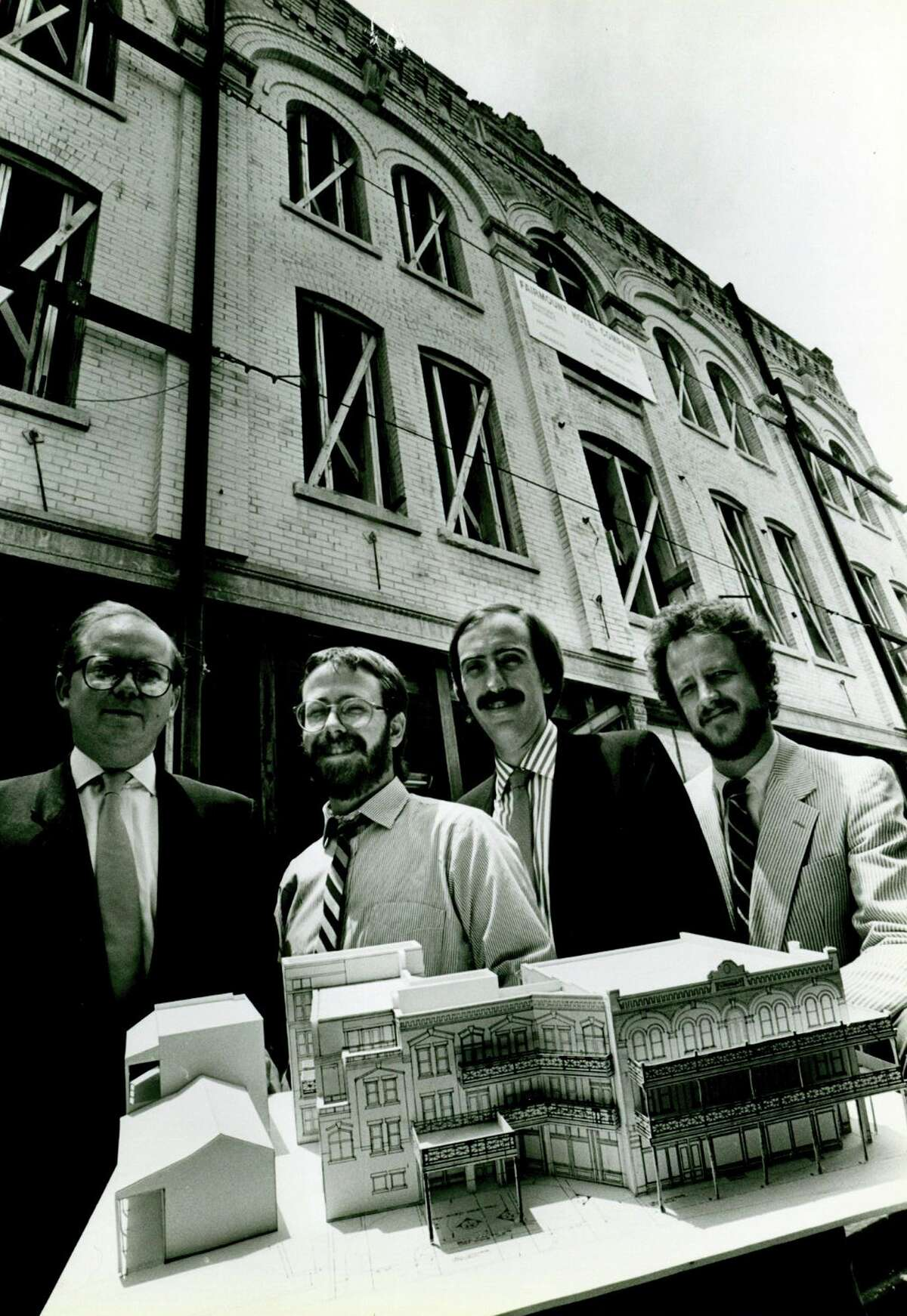 """A team from Alamo Architects with a model at the Fairmount Hotel, which was the firm's first """"job of consequence"""" in 1984. From left, Michael Lanford, Billy Lawrence, Irby Hightower and Mike McGlone."""