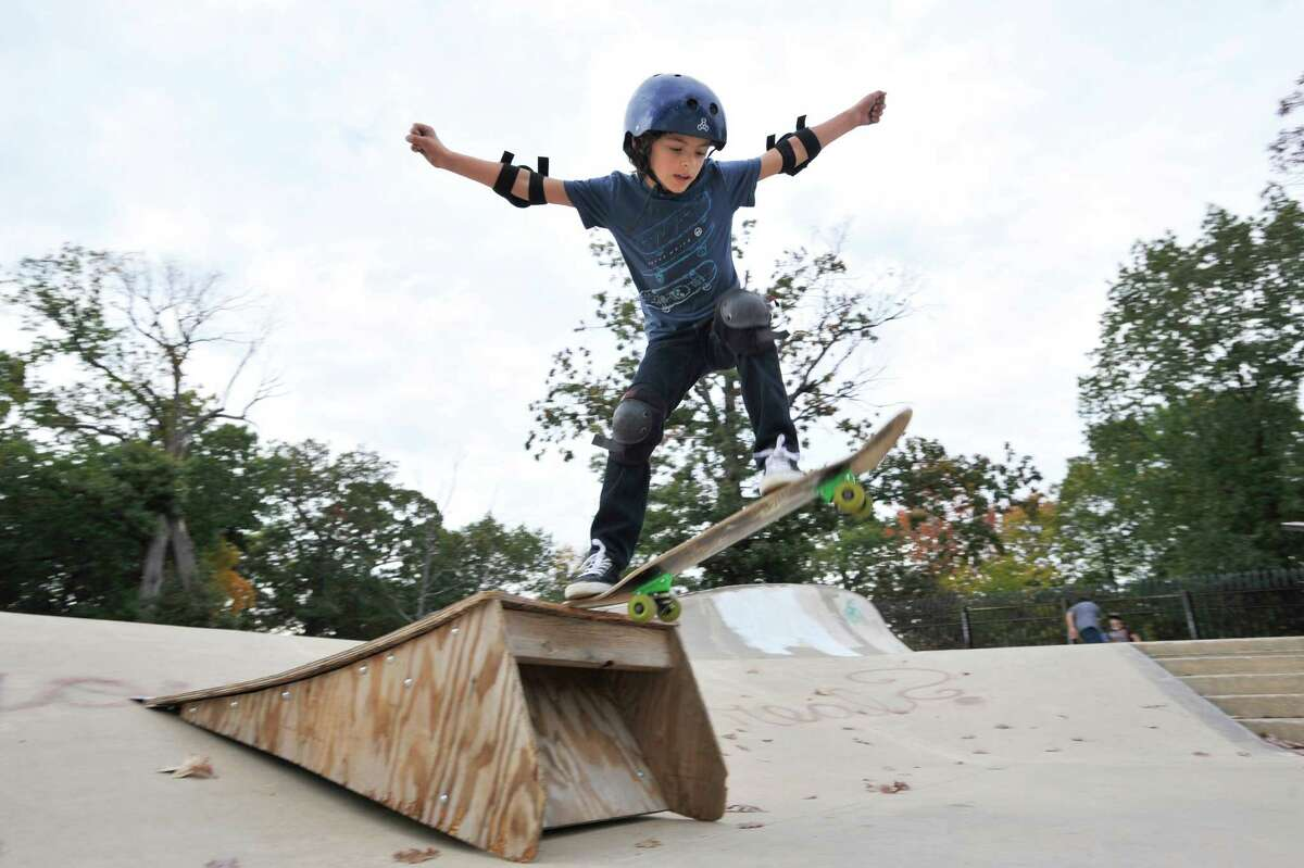 Seven year old Hudson Squires, from Greenwich, skates over a ramp at the Scalzi Skate Park in Stamford on Thursday, Oct. 22, 2015.