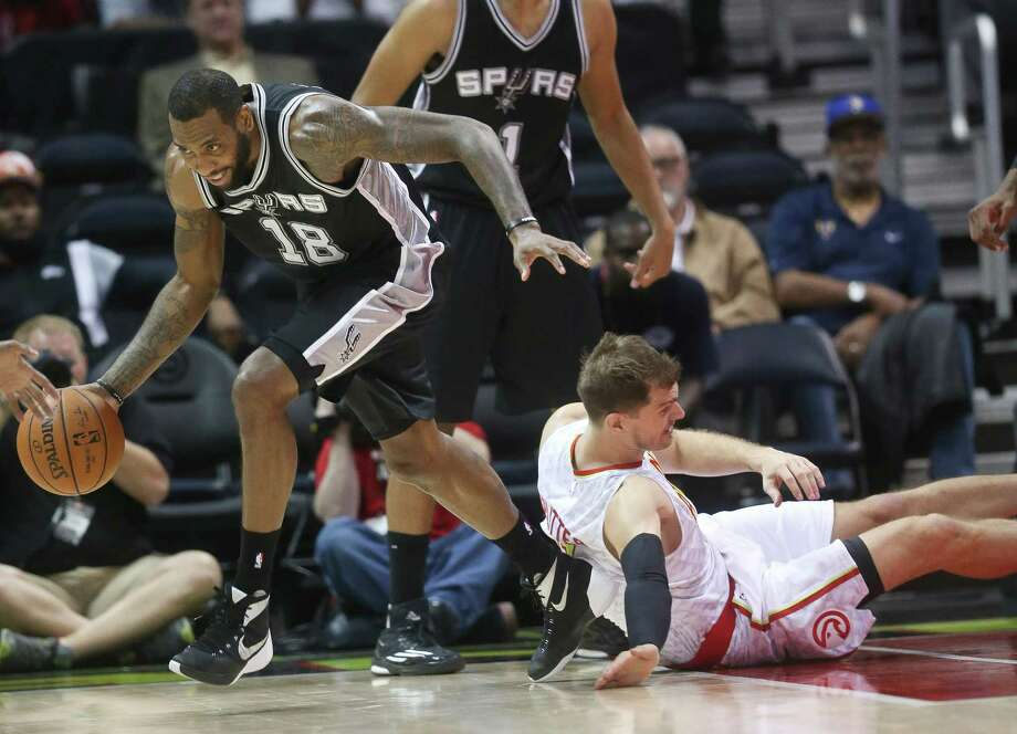 Spurs forward Rasual Butler comes up with a loose ball against Hawks forward Tiago Splitter in the first first half of a preseason game on Oct. 14, 2015, in Atlanta. Photo: John Bazemore /Associated Press / AP