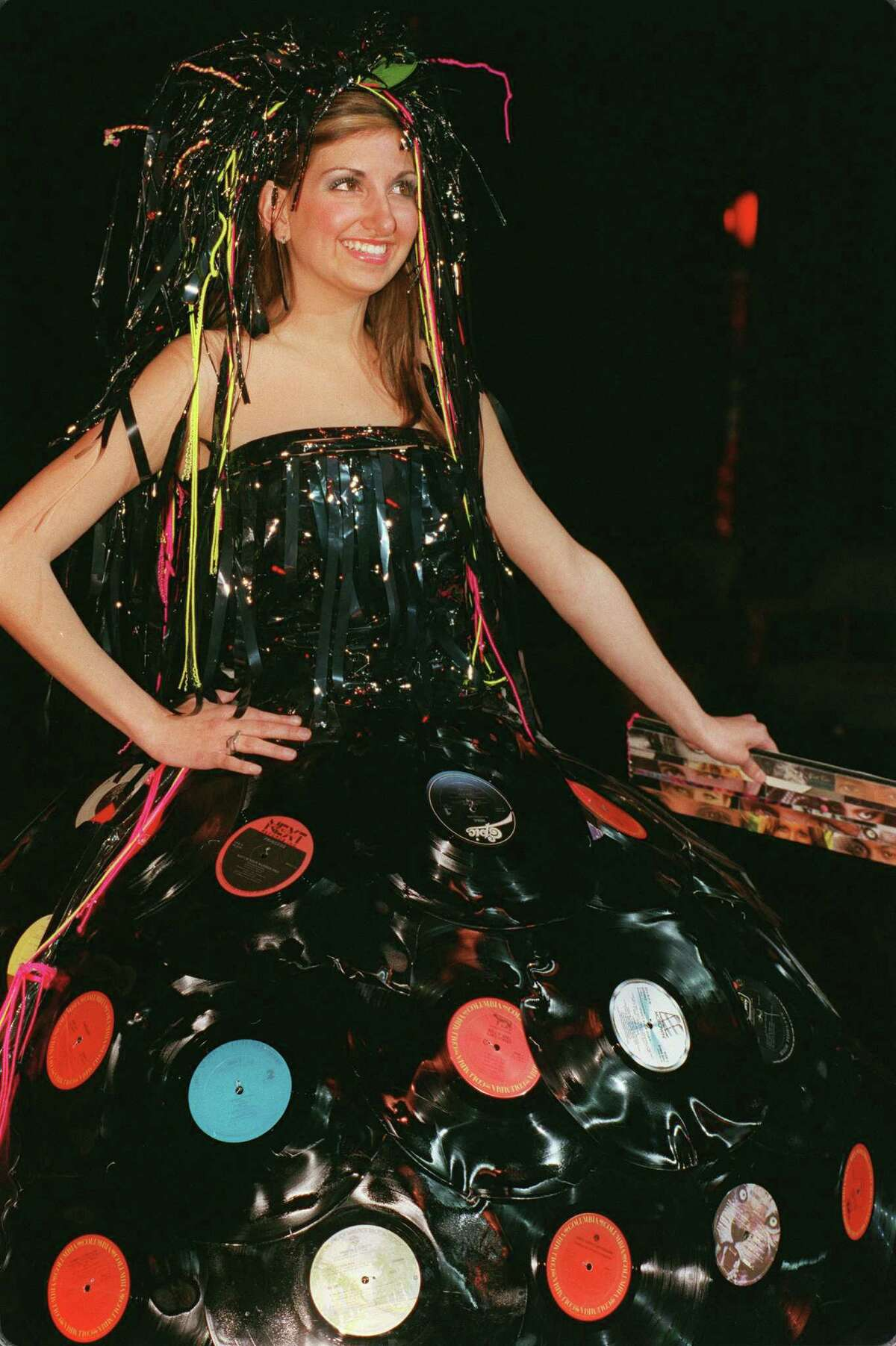 """From a file photo, a model wears the""""Video Killed the Radio Star"""" bellum skirt made from record albums melted together for the Flash & Trash fashion show is a design contest of garments made from recycled materials."""
