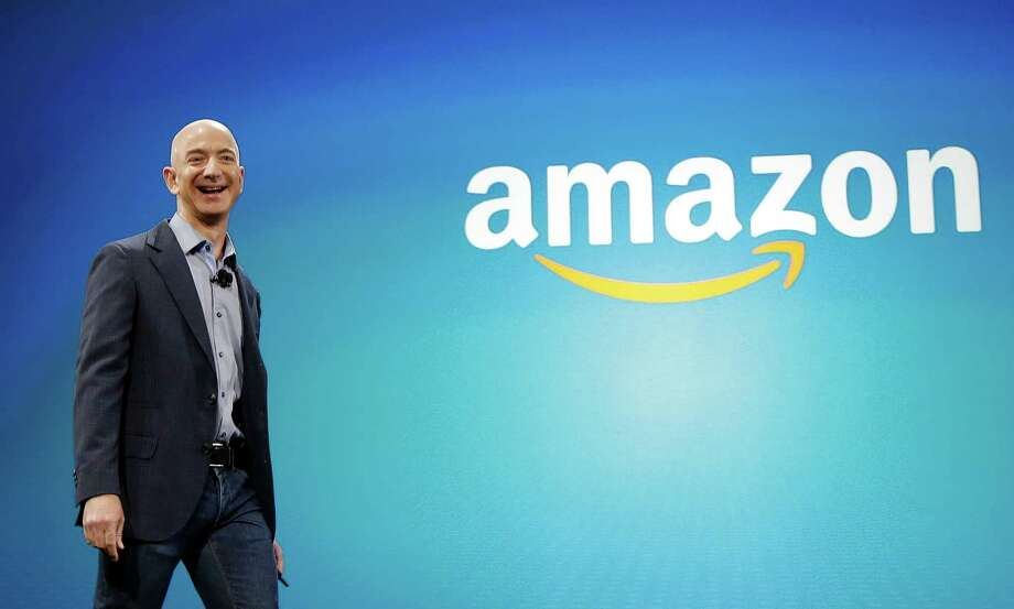FILE - In this June 16, 2014 file photo, Amazon CEO Jeff Bezos walks on stage for the launch of the new Amazon Fire Phone, in Seattle. Amazon.com reports quarterly financial results on Thursday, Oct. 23, 2014. (AP Photo/Ted S. Warren, File) Photo: Ted S. Warren /Associated Press / AP