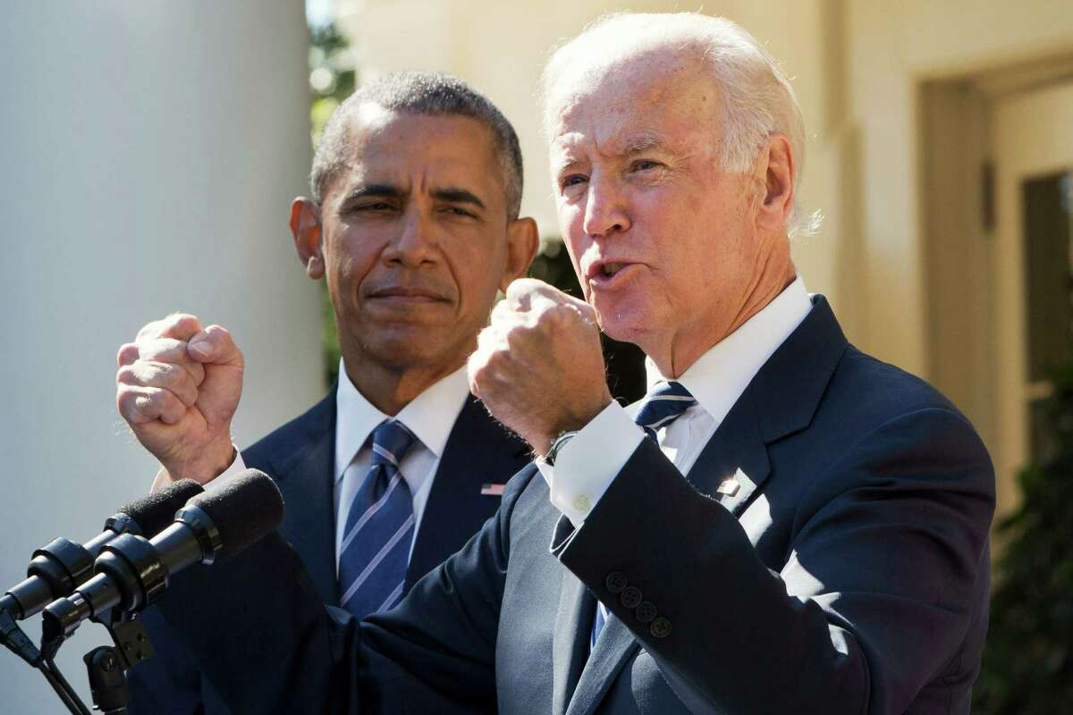 Vice President Joe Biden, with President Barack Obama, gestures as he speaks in the Rose Garden of the White House in Washington, Wednesday, Oct. 21, 2015, to announce that he will not run for the presidential nomination. (AP Photo/Jacquelyn Martin)