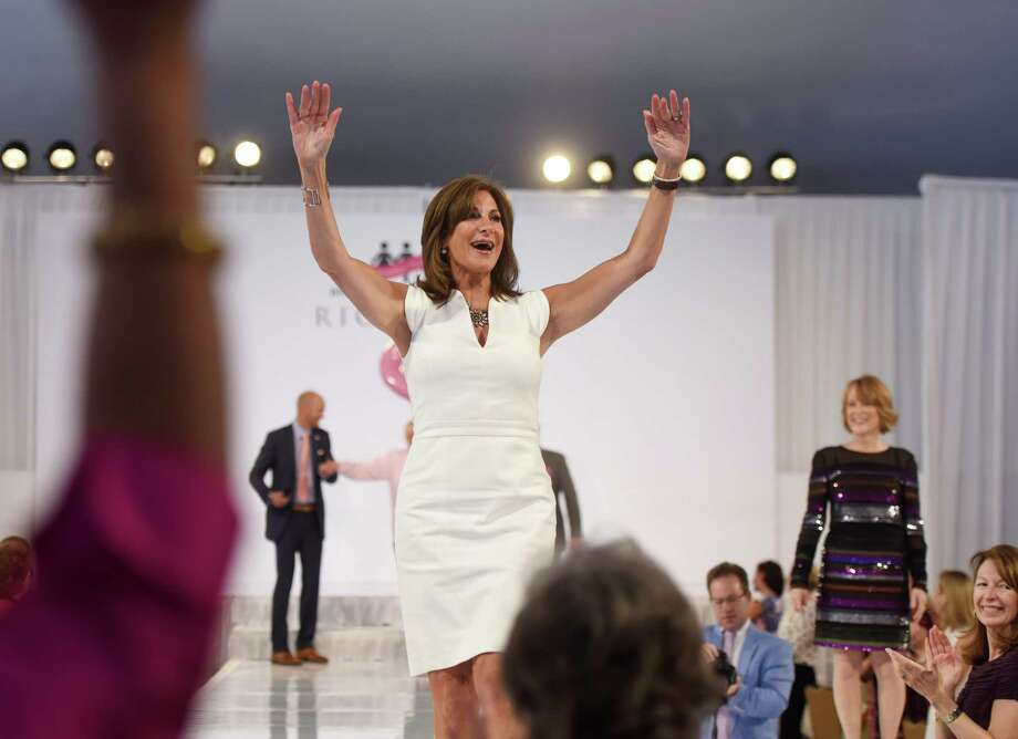 Debbi O'Shea, a breast cancer survivor and consultant at the women's clothing store Richard's, waves after walking down the runway at the 20th Annual Breast Cancer Alliance Benefit Luncheon and Fashion Show at the Hyatt Regency in Old Greenwich on Thursday. Photo: Tyler Sizemore / Hearst Connecticut Media / Greenwich Time