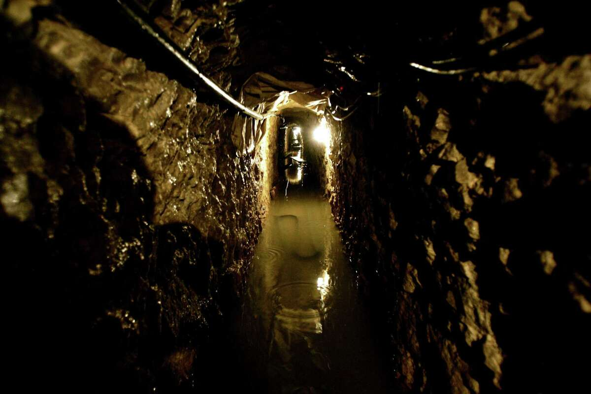 OTAY MESA, CA - JANUARY 30: View looking toward Mexico through a drug tunnel found along the Mexico/USA Border at a warehouse January 30, 2006 in Otay Mesa, California. The tunnel runs 2,400 feet; is furnished with lighting, ventilation and equipment to pump out ground water and was used to funnel drugs into the United States from Mexico.