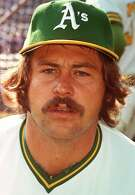 FILE -- Hall of Fame pitcher Catfish Hunter is shown in this 1973 photo in an Oakland A's uniform. Hunter, the Hall of Fame pitcher who ushered in baseball's era of big bucks for free agents, died today at age 53 after battling the disease named after another New York Yankees great, Lou Gehrig. (AP Photo/File)