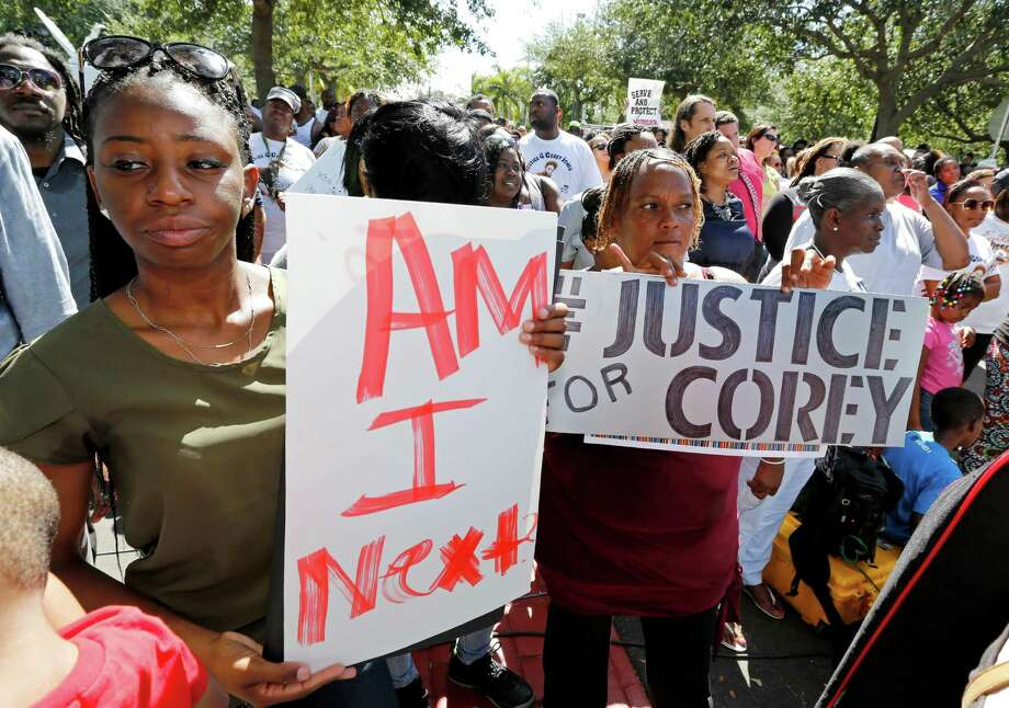 Attendees hold signs in support of Corey Jones, who was fatally shot by a South Florida police officer at a 'rally for answers' on Thursday, Oct. 22, 2015, in Palm Beach Gardens, Fla. (AP Photo/Joe Skipper) Photo: Joe Skipper, FRE / Associated Press / FR171174 AP