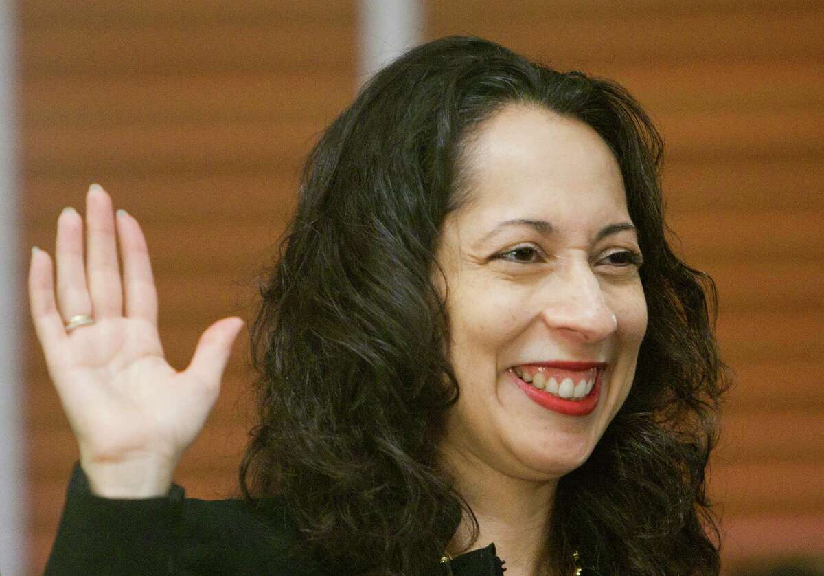 Civil Court Judge Debra Ibarra Mayfield raises her hand during a swearing-in ceremony for the newly elected judges and county officials at the 1910 Courthouse, Tuesday, Jan. 1, 2013, in Houston. (Cody Duty / Houston Chronicle)
