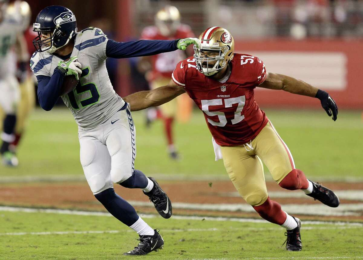 Seattle Seahawks wide receiver Jermaine Kearse (15) runs past San Francisco 49ers linebacker Michael Wilhoite (57) during the first half of an NFL football game in Santa Clara, Calif., Thursday, Oct. 22, 2015. (AP Photo/Ben Margot)