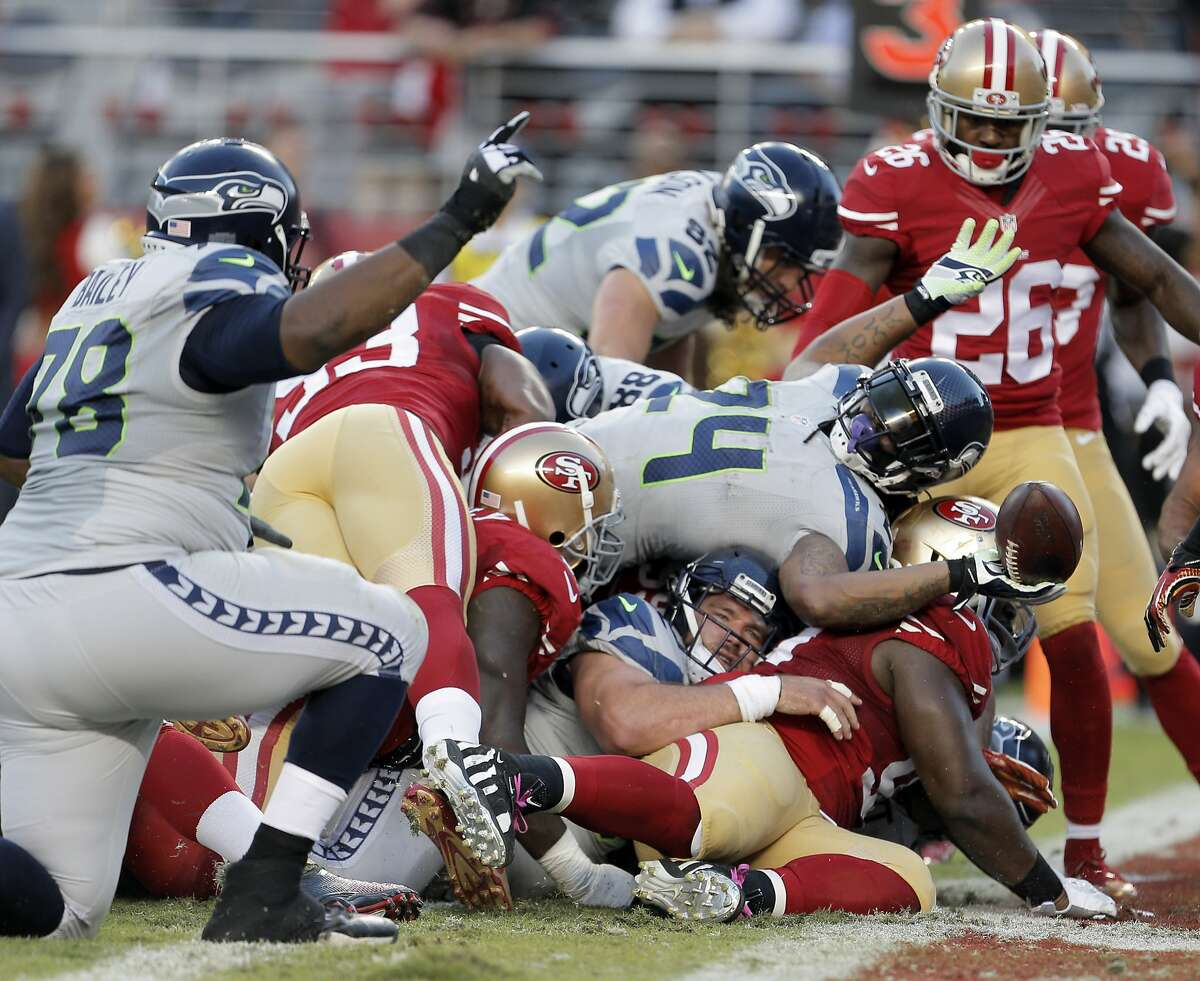 Marshawn Lynch (24) reacts after scoring in the first half of the 49ers game against the Seattle Seahawks at Levi's Stadium in Santa Clara, Calif., on Thursday, October 22, 2015.