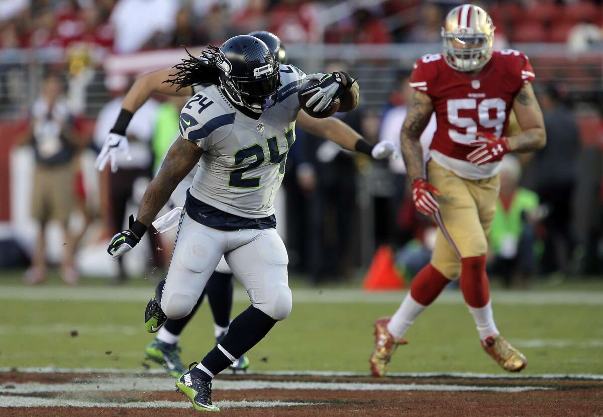 Marshawn Lynch (24) runs in the first half of the 49ers game against the Seattle Seahawks at Levi's Stadium in Santa Clara, Calif., on Thursday, October 22, 2015.