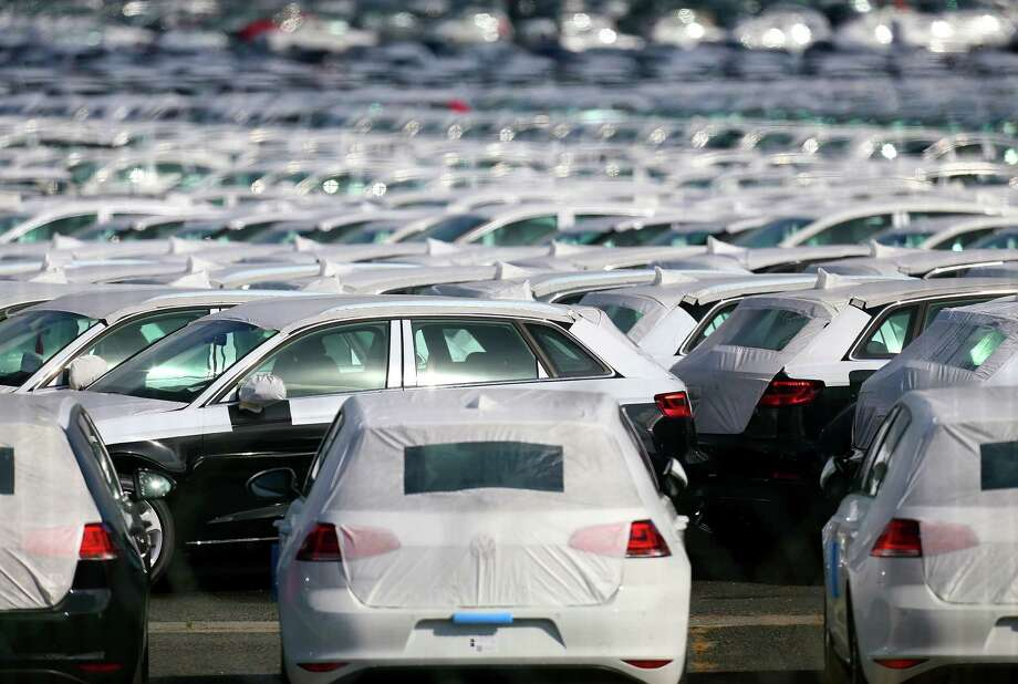 (FILES) This September 25, 2015 file photo shows cars parked at the logistics park of German auto giant Volkswagen in Villers-Cotterets. to recall 2.4 million diesel vehicles in Germany that are equipped with pollution-cheating software, a spokesman told AFP on October 15, 2015. AFP PHOTO / FRANCOIS NASCIMBENIFRANCOIS NASCIMBENI/AFP/Getty Images Photo: FRANCOIS NASCIMBENI /AFP / Getty Images / AFP
