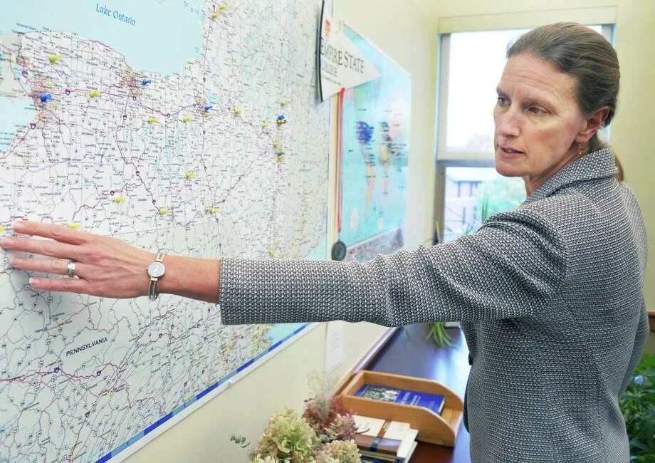 Empire State College President Merodie Hancock uses a map of New York State to explain makeover plans for its administrative functions at the college headquarters Thursday Oct. 22, 2015 in Saratoga Springs, NY.  (John Carl D'Annibale / Times Union) Photo: John Carl D'Annibale / 10033905A