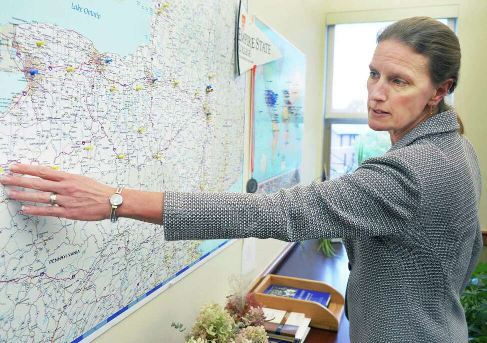 Empire State College President Merodie Hancock uses a map of New York State to explain makeover plans for its administrative functions at the college headquarters Thursday Oct. 22, 2015 in Saratoga Springs, NY. (John Carl D'Annibale / Times Union)