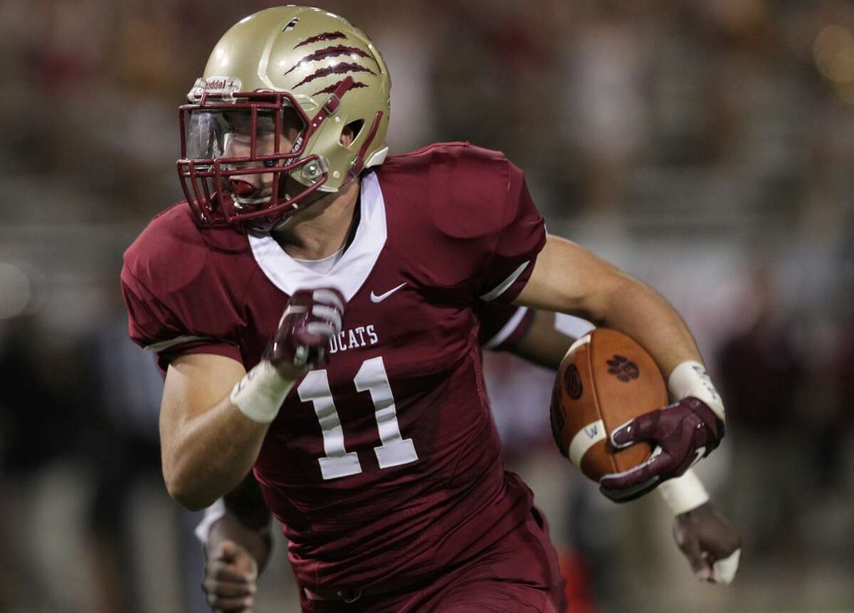 Cy Woods 44, Cy-Fair 7 Cypress Woods' Brandon Deprato (11) runs back an intercept pass in the first half of prep football action between Cy-Fair and Cypress Woods on Thursday, Oct. 22, 2015, in Cypress. ( Elizabeth Conley / Houston Chronicle )