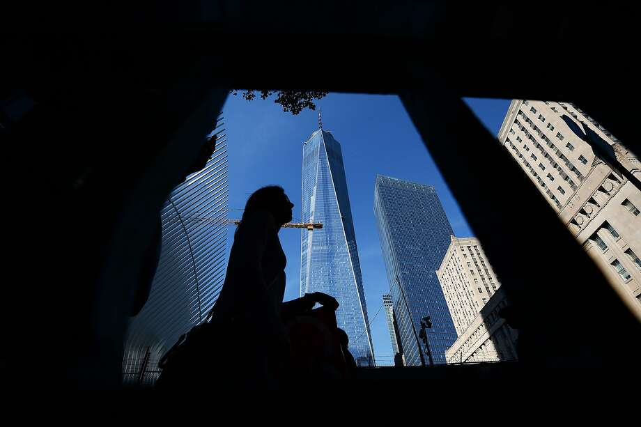 A woman makes her way past the One World Trade Center building in New York on October 21, 2015.  Photo: Jewel Samad, AFP / Getty Images