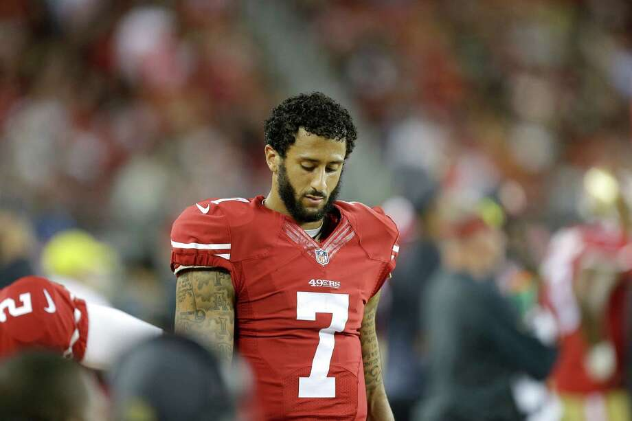 San Francisco 49ers quarterback Colin Kaepernick stands on the sideline during the second half of an NFL football game against the Seattle Seahawks in Santa Clara, Calif., Thursday, Oct. 22, 2015. Photo: Ben Margot, Associated Press / AP
