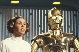 """LOS ANGELES - AUGUST 23: Carrie Fisher (as Princess Leia Organa) and Anthony Daniels (as C3PO) star in the CBS television """" THE STAR WARS HOLIDAY SPECIAL.""""  Image dated August 23, 1978."""