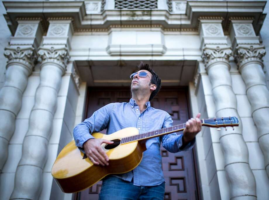 """Tompkins Square Records' Josh Rosenthal plays his guitar in San Francisco. Rosenthal has a book coming out on Oct. 27, """"The Record Store of My Mind,"""" part memoir and part music criticism exploring his life in the music business. Photo: Nathaniel Y. Downes, The Chronicle"""