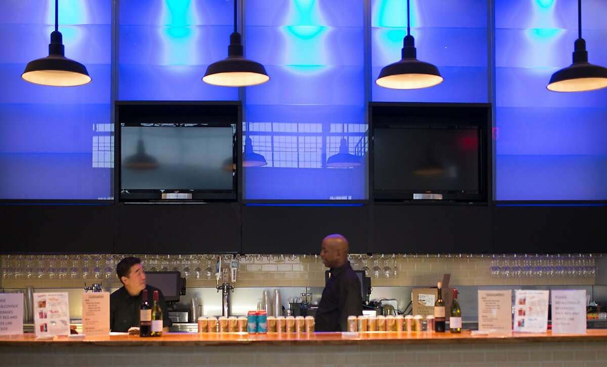 From left, Brandon Cono and Wendell Smith, bartenders at the Annual Meeting of The Minds, an event where the future of urban sustainability is reviewed, work behind the bar in Craneway Pavilion on Thursday, Oct. 22, 2015 in Richmond, Calif.