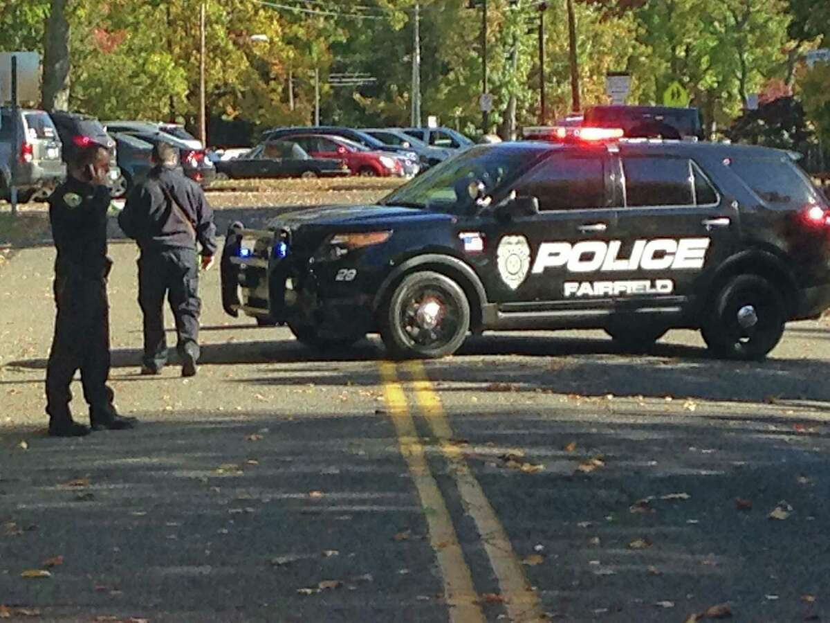 Fairfield police block the road leading to Holland Hill School. On Friday, Oct. 23, all schools were placed under a lockdown after a series of threatening calls were made.