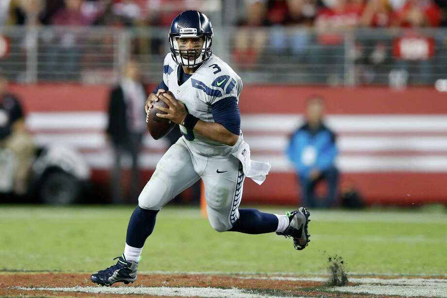 Quarterback:Russell Wilson completed 18 of his 24 pass attempts and showed some real touch on long balls downfield, including his 43-yard touchdown bomb to Tyler Lockett in the second quarter. But two bad interceptions, including his second red-zone pick in three weeks, bring this grade down. Grade: B Photo: Ezra Shaw, Getty Images / 2015 Getty Images