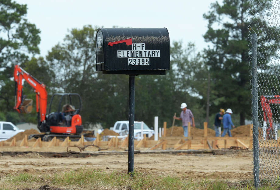 Construction crews prepare to lay a foundation for Hamshire-Fannett's new gym on Thursday. A large section of the school was destroyed in a 2014 fire. Currently, the school's third grade classes are learning from portable buildings with hopes of being in classrooms by August of 2016.  Photo taken Thursday, October 22, 2015  Guiseppe Barranco/The Enterprise Photo: Guiseppe Barranco, Photo Editor