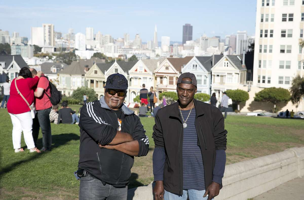 Wiley Miskel and William King pose for a picture in front of Alamo Square Park on Monday, October 19, 2015 in San Francisco, Calif. The two friends frequently meet at Alamo Square Park to play music and wash their cars. (Photo by Erin Brethauer)