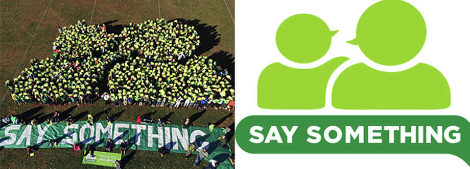 Broadview Middle School in the formation of Sandy Hook Promise's 'Say Something' logo Friday. Photo: / Contributed