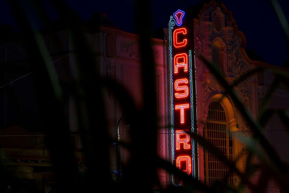 The Castro Theatre's lights glow in the night on Tuesday, October 6, 2015 in San Francisco, Calif. Since the first death of a man in 1981 who succumbed to a disease that did not yet have a name, AIDS has taken 20,000 lives in San Francisco, most of them gay men, most of them decades too soon. The weight of the scourge was borne by the men who settled in a 2-square-mile enclave in the heart of the city, the Castro. (Photo by Erin Brethauer) Photo: Erin Brethauer, The Chronicle