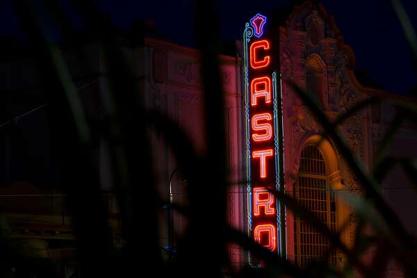 The Castro Theatre's lights glow in the night on Tuesday, October 6, 2015 in San Francisco, Calif. Since the first death of a man in 1981 who succumbed to a disease that did not yet have a name, AIDS has taken 20,000 lives in San Francisco, most of them gay men, most of them decades too soon. The weight of the scourge was borne by the men who settled in a 2-square-mile enclave in the heart of the city, the Castro. (Photo by Erin Brethauer)