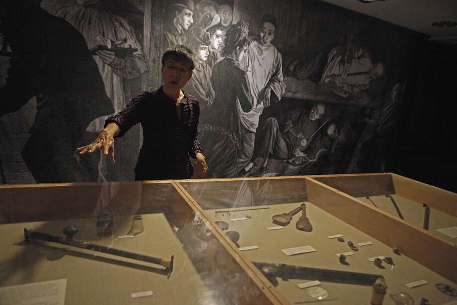 Executive Director Sue Lee talks about the Opium paraphernalia history and perceptions during a tour of  Underground Chinatown exhibit  located in the lower level of the Chinese Historical Society of America Museum on October 24, 2015. Photo: Franchon Smith, The Chronicle