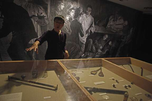 Executive Director Sue Lee talks about the Opium paraphernalia history and perceptions during a tour of  Underground Chinatown exhibit  located in the lower level of the Chinese Historical Society of America Museum on October 24, 2015.