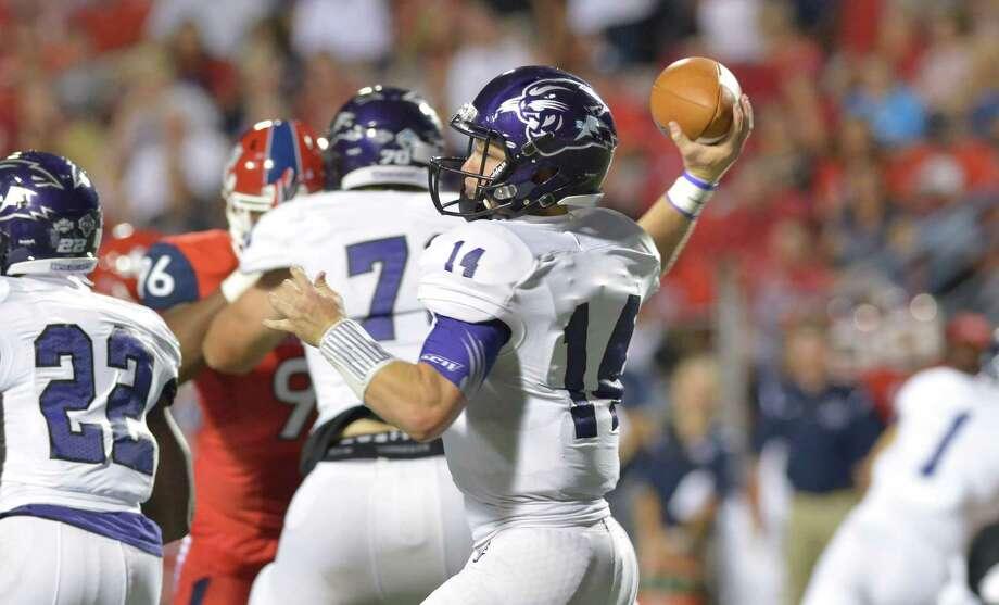 Abilene Christian quarterback Parker McKenzie, a Smithson Valley product, passes during the 2015 season. Photo: Rick Dodd /Abilene Christian Athletics