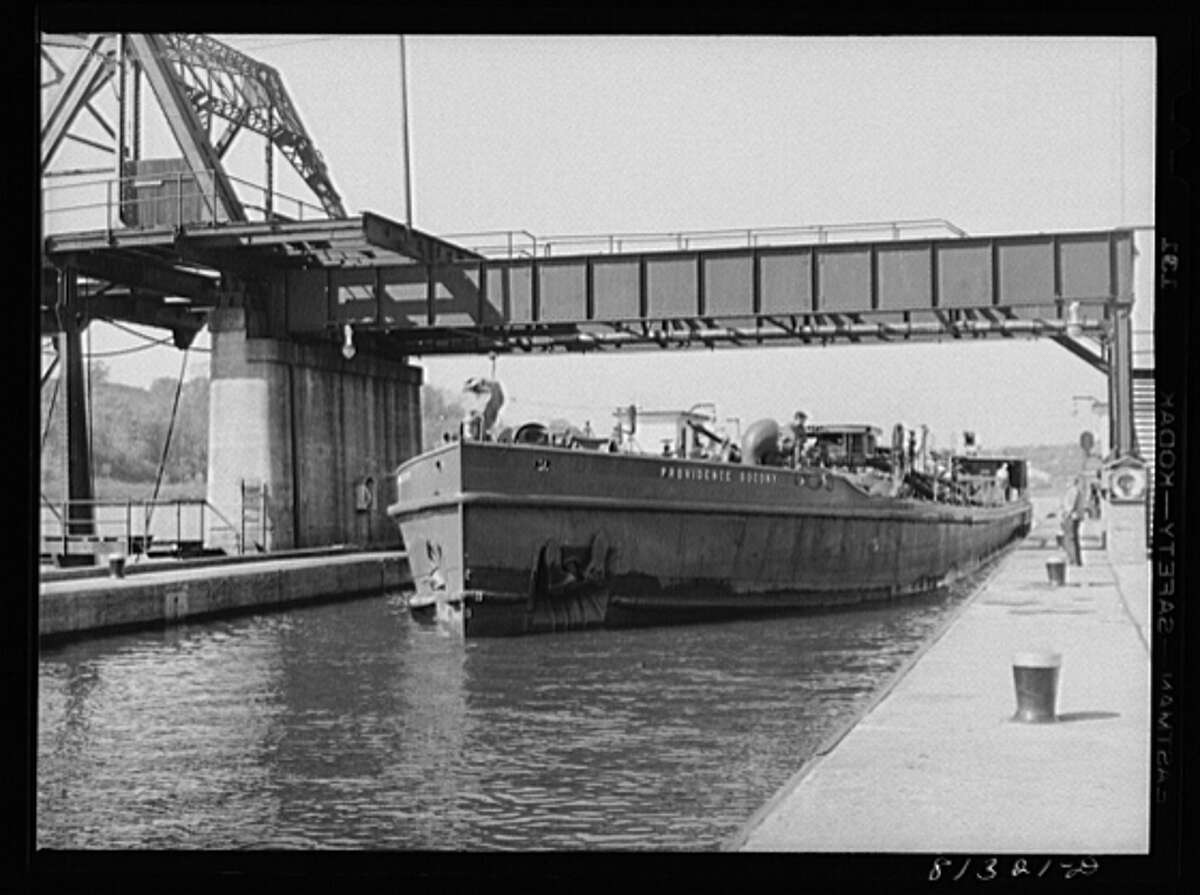 Oil carrier powered by diesel engine enters Lock Eleven, Amsterdam, New York, 1941.