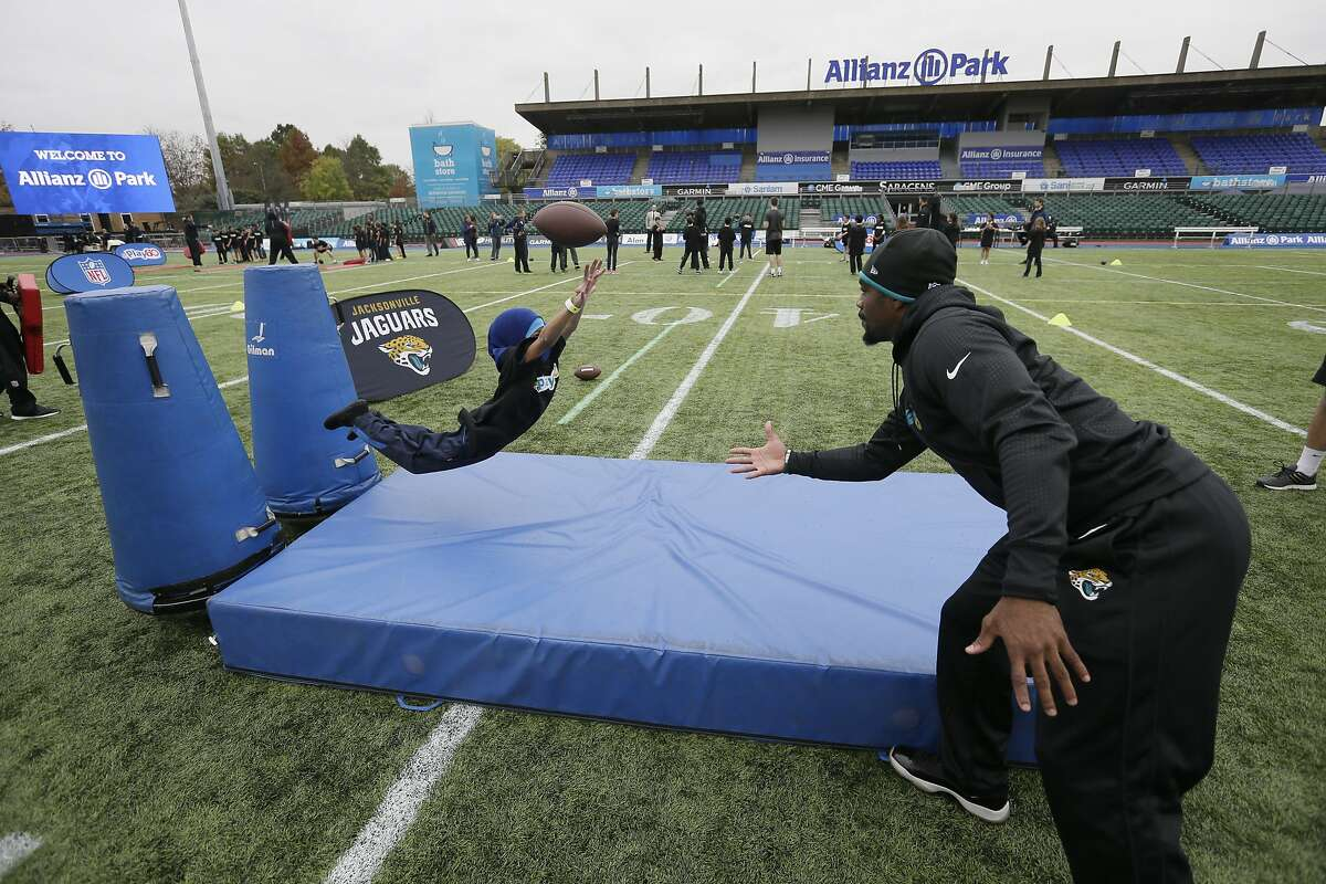 Jacksonville Jaguars Rasheed Bailey takes part in community day activities with local schoolchildren following a training session at Allianz Park in London, Friday Oct. 23, 2015. The Jaguars are preparing for an NFL football game against the Buffalo Bills at London's Wembley stadium on Sunday. (AP Photo/Tim Ireland)