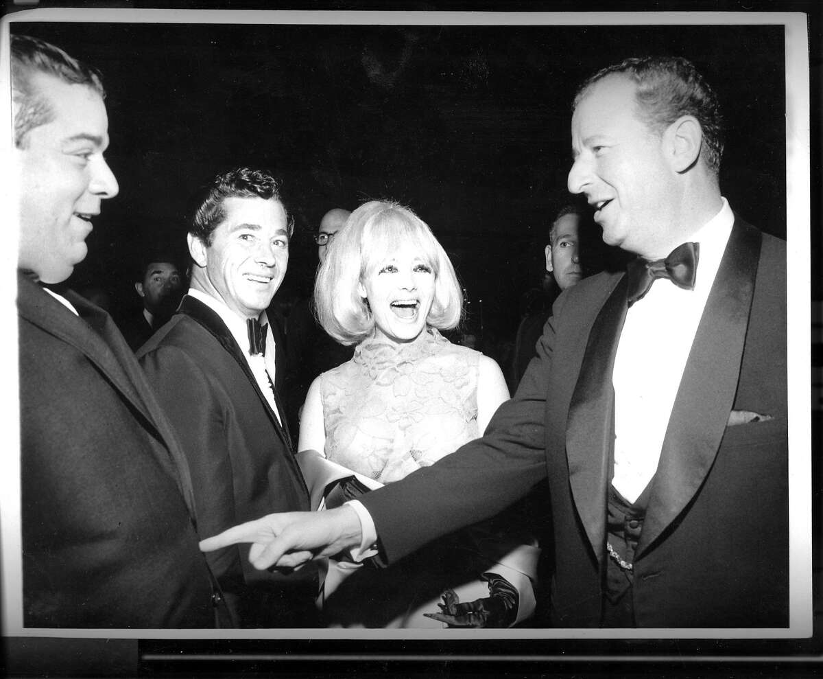 L-R: Dave Rosenberg, Gino Del Prete, Carol Doda and Herb Caen at the Condor club on Oct 22 1965.