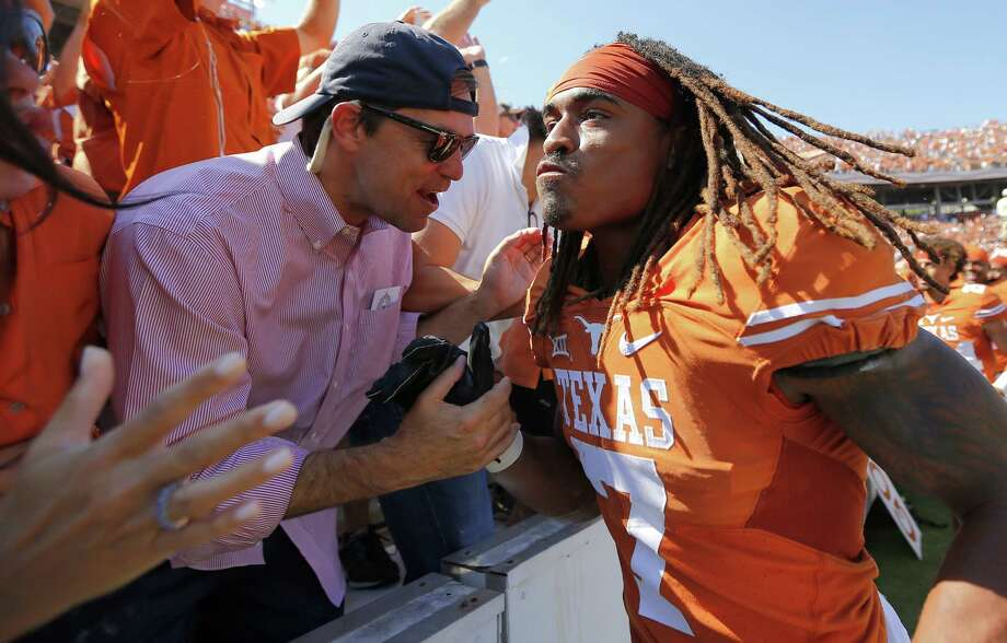 Texas wide receiver Marcus Johnson celebrates with fans after a 24-17 win against Oklahoma at the Cotton Bowl in Dallas on Oct. 10, 2015. Photo: Brandon Wade /Fort Worth Star-Telegram / Fort Worth Star-Telegram
