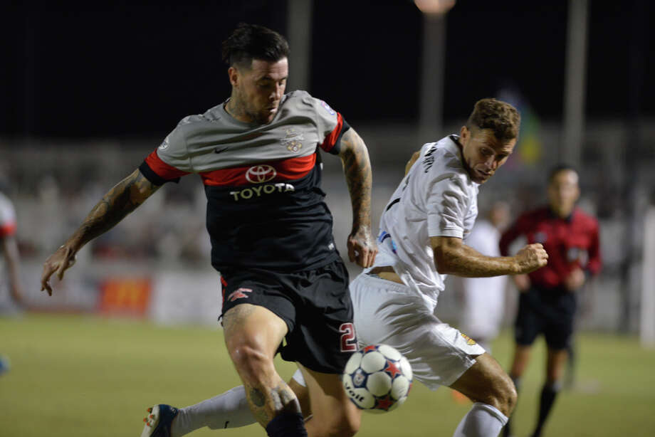 Scorpions' Eric Hassli battles Ft. Lauderdale's Franki Sanfilippo during their North American Soccer League match on Oct. 3, 2015, at Toyota Field. Photo: Robin Jerstad /For The Express-News