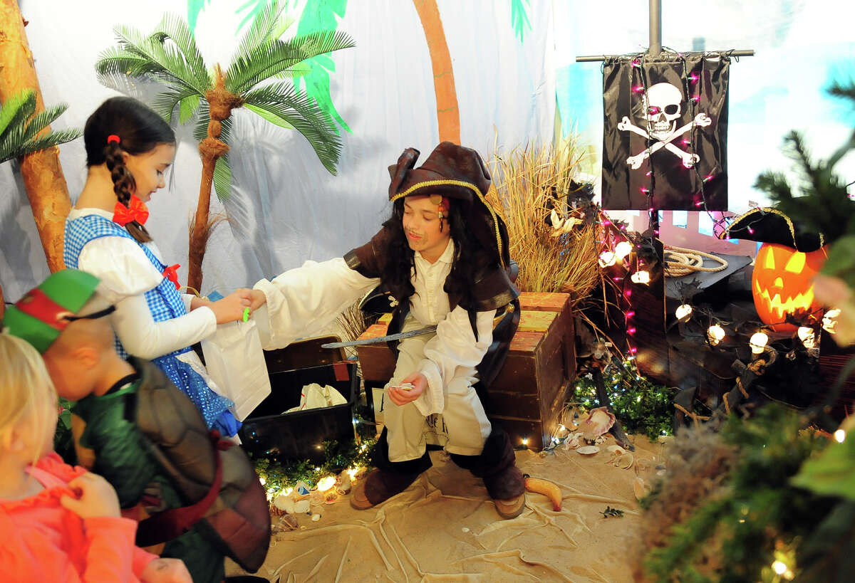 """In this file photo, Pirate Jack Sparrow, played by Leo Redgate, entertains visitors during """"The Enchanted Castle"""" event at the Burr Homestead in Fairfield. A record number of Americans will shop for Halloween this year, according to the National Retail Federation."""