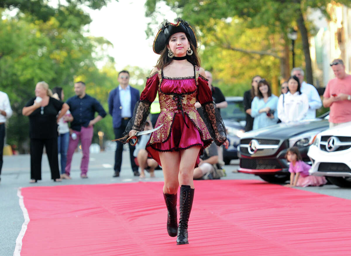 Chloe Tachibana (left) wore a pirate costume from Sophia's Costume Rentals of Greenwich during the fifth annual Fashion on the Avenue event in front of the Greenwich Senior Center building on Greenwich Avenue. The costume is an example of what can be found at Sophia's, where many people go to find the perfect Halloween costume.
