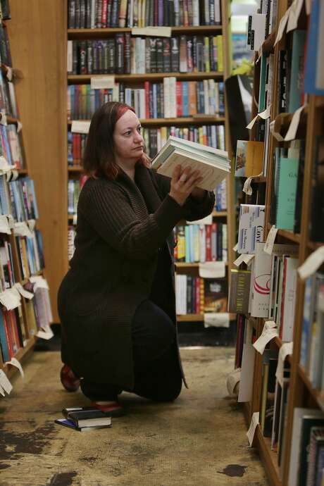 Christin Evans, owner Booksmith; board member Haight Ashbury Neighborhood Association and resident of Ashbury at Haight Street, shelves books while working at the Booksmith on Friday, October 23,  2015 in San Francisco, Calif. Photo: Lea Suzuki, The Chronicle
