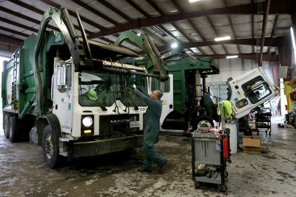 Garbage trucks are serviced at the Waste Management facility on Todd Road earlier this week.